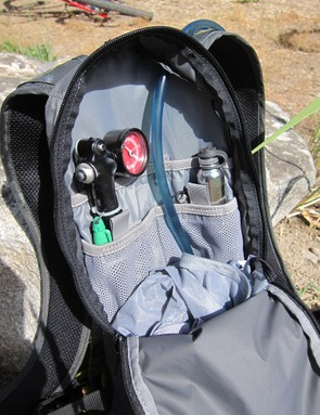 The single zippered main compartment is well organized and spacious enough for pumps, tools, spare tubes, several extra layers, and some food