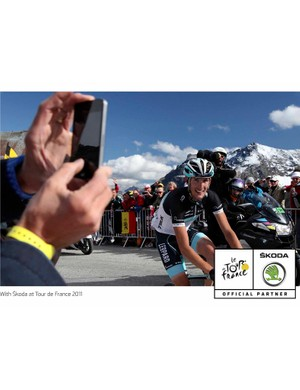Only knowing the stage is in the bag would cause a man to smile like this on the Galibier