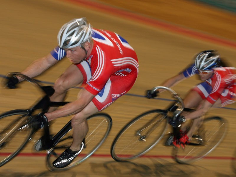Sir Chris Hoy and Victoria Pendleton in action on the track