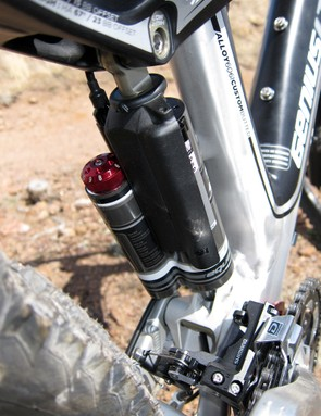 A plastic guard protects the rear shock from debris flying off of the rear tire