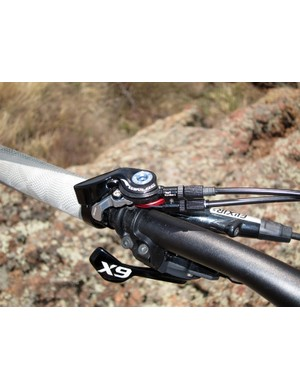 The TwinLoc lever is connected to both the rear shock and the fork damper, allowing quick personality changes for climbs, downhills, and everything in between