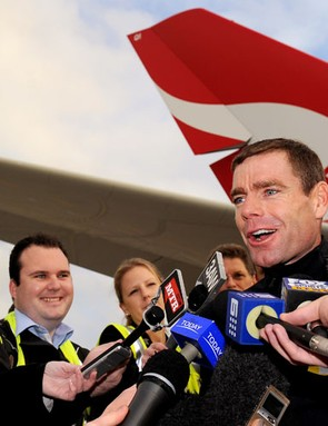 Evans talks to the media on the tarmac at Melbourne Airport
