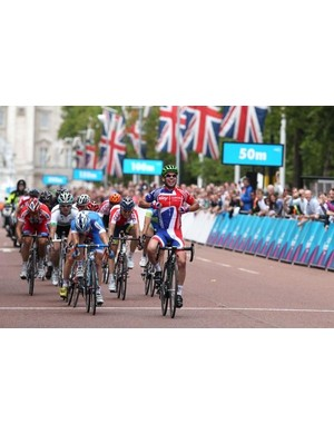 Mark Cavendish (Great Britain) celebrates as he beats Sacha Modolo (Italy) and Samuel Dumoulin (France) to win the London-Surrey Classic road race