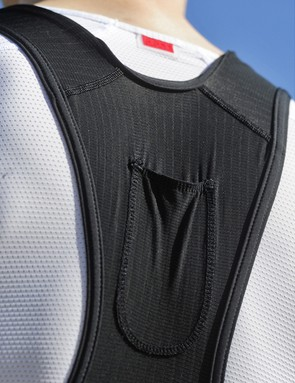 The high yoke helps keep the mesh bib straps in place. A small pocket is included up top for a small music player or two-way radio