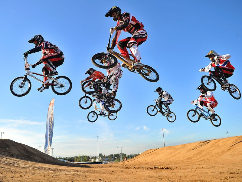 BMX riders compete in the final heats of the UCI BMX Supercross World Cup at the Olympic BMX course in Stratford, East London