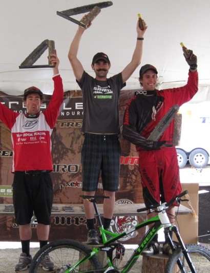 The men's overall podium: (L to R) Nathan Hills, third; Ross Schnell, first; Brian Buell, second