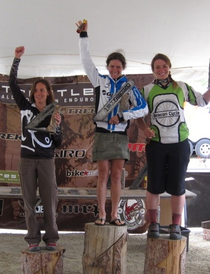 The women's overall podium: Alicia Jakomait, third; Kelli Emmett, first; Rebecca Gardner, second