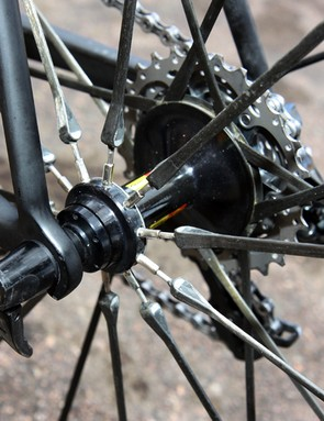 The rear hub on Mavic's Cosmic Carbone Ultimate wheel uses carbon spokes but it can still be trued thanks to short threaded sections on the non-driveside.