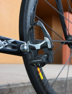 The carbon-bodied Shimano Dura-Ace SPD-SL pedals show signs of crash damage.