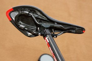 The carbon fiber shell on fi'zi:k's Arione CX Carbon Braided saddle is ultralight but also provides some tuned flex relative to the nylon shell.