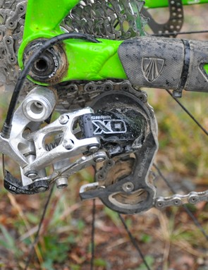 A short-cage SRAM X0 rear mech takes responsibility for shifting in all-mountain conditions
