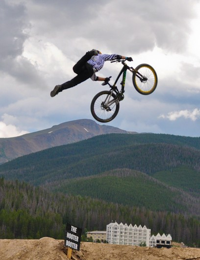 Cam McCaul throws an Indian Air off Crankworx Colorado's Hooter Booter while working his way to top qualifier