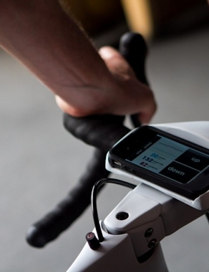 An iPhone is used as the computer connection between the rider and Shimano Di2 group