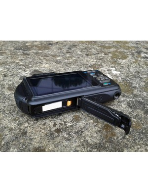The SD card and battery sit in this sealed compartment on the Pentax Optio WG-1 GPS