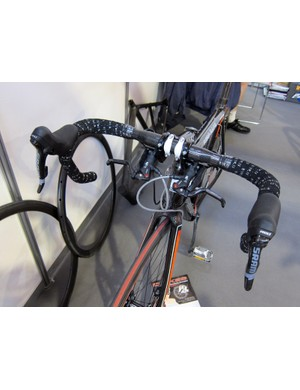 This DBikes creation doesn't rely on a converter. Instead, DBikes have put together their own adapter system that physically pulls the brake lever on a Formula master cylinder. Not the most elegant solution but apparently effective