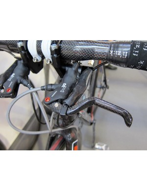 DBikes' setup includes their own master cylinder mount and a concealed cable anchor that physically pulls the hydraulic brake lever