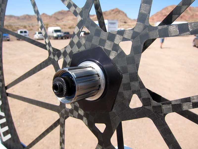 Next-generation Mad Fiber wheels will use a new one-piece driveside spoke assembly that looks more finished than the original setup.  Mad Fiber creator Ric Hjertberg stresses that the underlying unidirectional fiber orientation and design is still identical, though