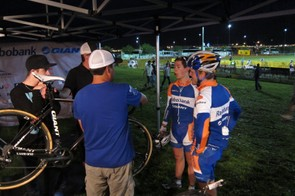 Giant's young guns: Danny Hart (far left) gives Bart Arenouts and Lars van der Harr (the current U23 cyclo-cross world champion) tips for riding in the wet; van der Harr would go on to win the event in a photo finish