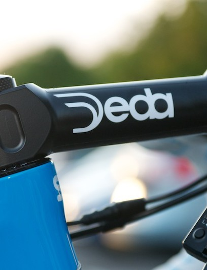 Dowsett uses a long, negative rise Deda stem to maintain his stretched out aero position.