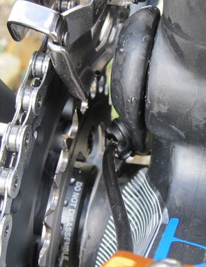 Rear derailleur housing threads tightly between the main pivot and the chainrings