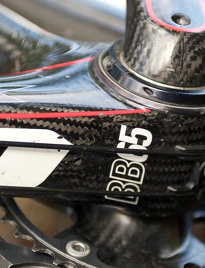Oversized and squared down tube envelops the BB65 bottom bracket shell