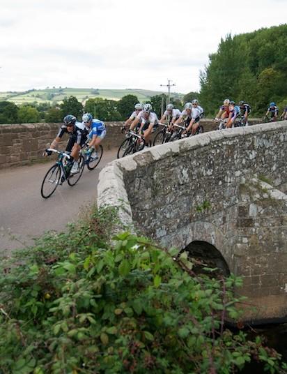 Stage 5: Lars Boom leads over a stone bridge