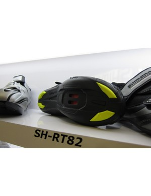 Shimano's SH-RT82 (Road Touring) offers the road look, with an SPD-style two-bolt cleat attachment and a rubber outsole for surefooted walking