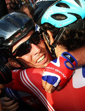 Cavendish is congratulated by his teammates after the victory