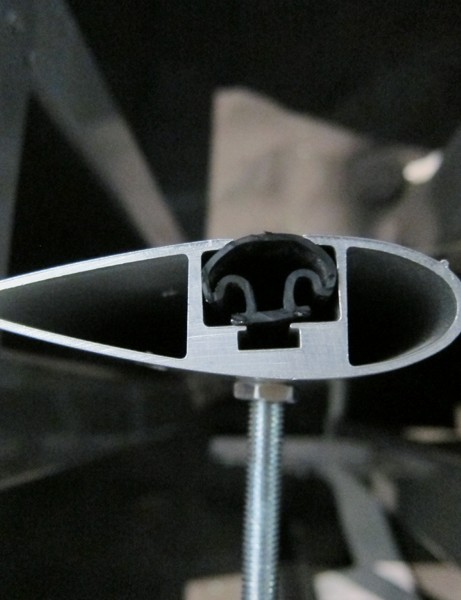 The new Yakima Whispbar uses an aerodynamic cross-section to reduce wind noise. Unique to the system is the mushroom-shaped rubber insert, which compresses to accommodate different gear mounts instead of needing to be cut