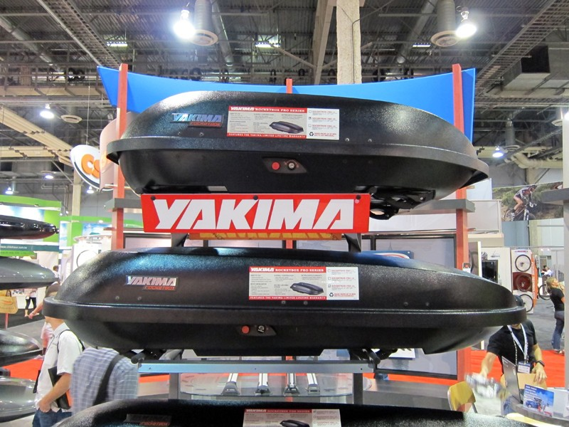 Yakima's redesigned Rocketbox Pro Series cargo boxes feature tops and bottoms that nest inside themselves for shipping. This doesn't reduce shipping costs but it does mean they can now ship via standard UPS and FedEx carriers