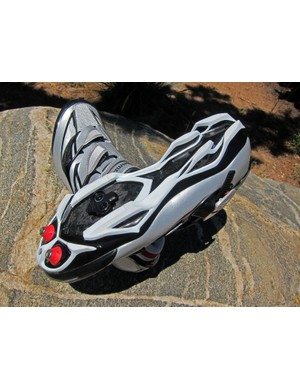 The stiff carbon fiber outsole is covered nearly end-to-end with grippy rubber. Removable toe spikes provide additional grip on softer terrain and the covered midsection is safer in the event of a missed pedal than with previous Shimano carbon shoes