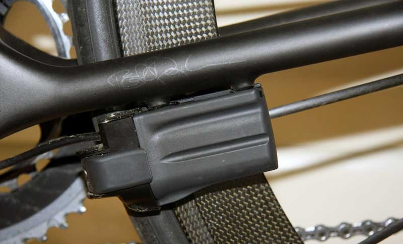 All the cable stops are removed, replaced by a dedicated carbon fiber battery mount with no rivets