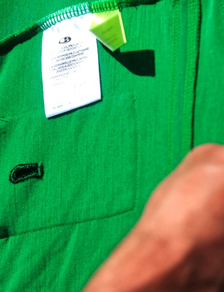One of the smaller pockets on the Icebreaker SS Circuit jersey includes a pass-through for headphone wires.  A tag on the inside of every Icebreaker garment allows owners to track the wool back to the actual sheep from which it came