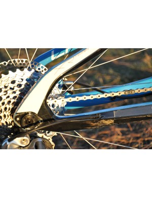 The rear derailleur shifter cable is routed through the chainstay
