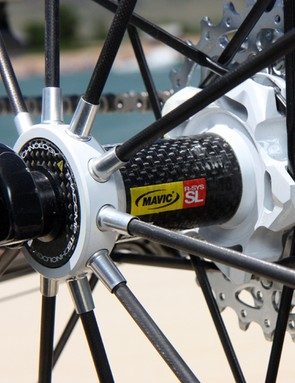 The Mavic R-Sys SL rear wheel uses tubular carbon fiber spokes on the non-driveside and bladed alloy spokes on the driveside