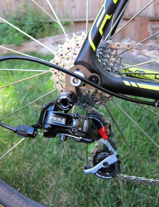 The SRAM Black Red rear derailleur is bolted to a stout-looking machined aluminum hanger