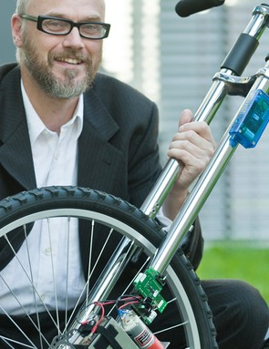 Professor Holger Hermanns with the wireless bicycle brake created at Saarland University's Saarbrücken Computer Science centre