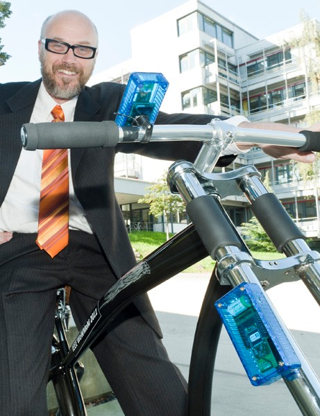 Professor Holger Hermanns with the wireless bicycle brake created at Saarland University