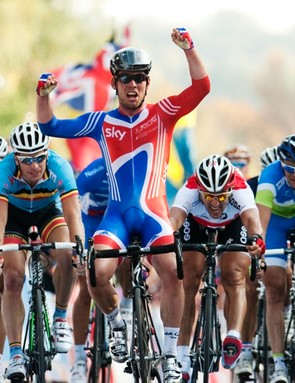 Mark Cavendish of Britain (C) crosses the finish line to win the 2011 road world championships in Copenhagen