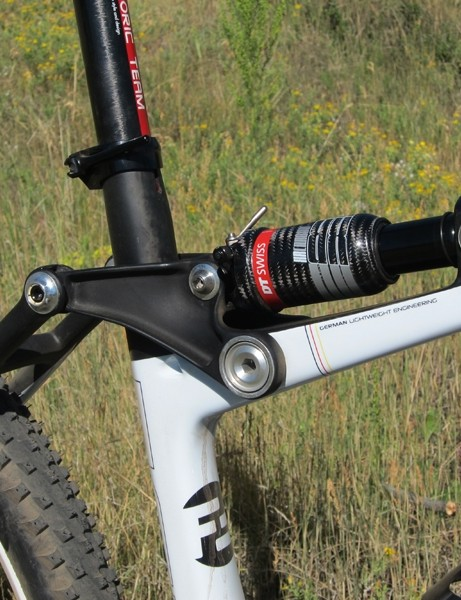 The carbon fiber rocker arm and carbon-bodied DT Swiss rear shock are mounted high up on the bike
