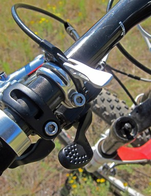 The remote fork lockout lever is compact and light but we had difficulty keeping it in the locked out position