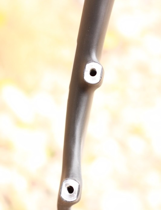 These two brake-mounting nuts are the only metal found in the fork