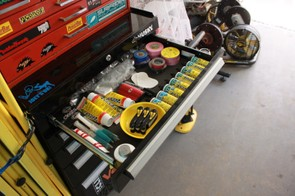 Inside the top drawer of the team's large tool box; those three multi-tools are the property of Jeremy Powers — he has a reputation for losing the mechanics' Allen wrenches, so they've got three that are all his own