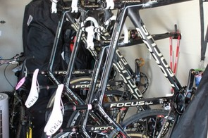 Team bikes are hung in the Service Course