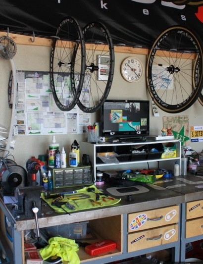 The rack above the workbench is for wheels being worked on