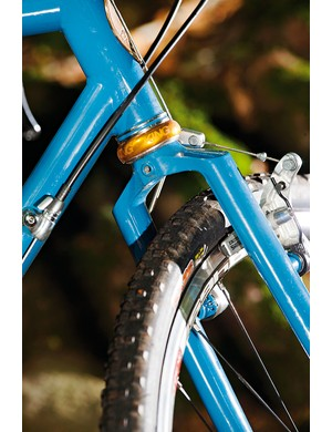 Collars reinforce the top and bottom of the head-tube