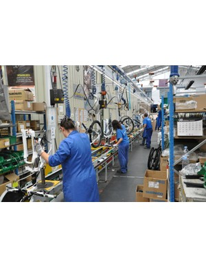 The majority of Orbea frames are assembled on this conveyor-assisted line
