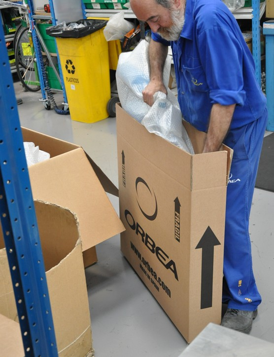 One of the 120 Orbea employees on the facility floor boxes a bike up for shipping