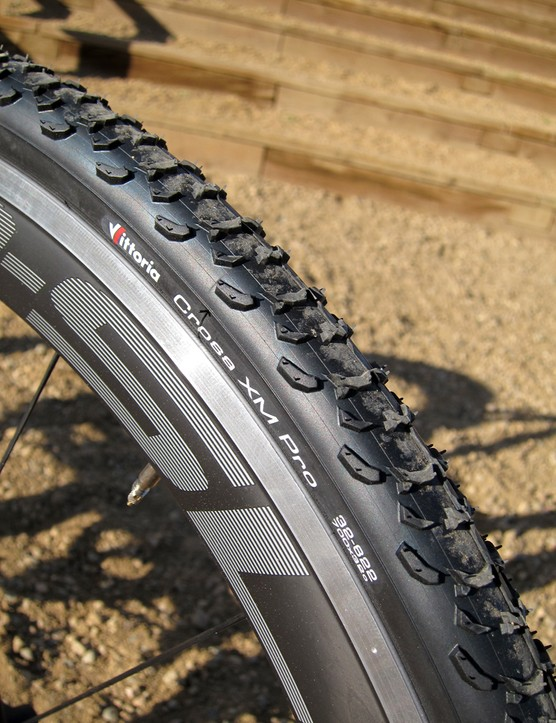 Vittoria Cross XM clinchers are wrapped around the Giant P-SLR1 Aero wheels. The open block design looks like it will clear mud well but looks questionable on hardpack courses