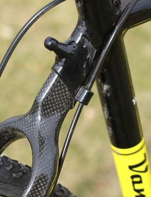 The G&T uses full cable housing from the top tube to the rear derailleur